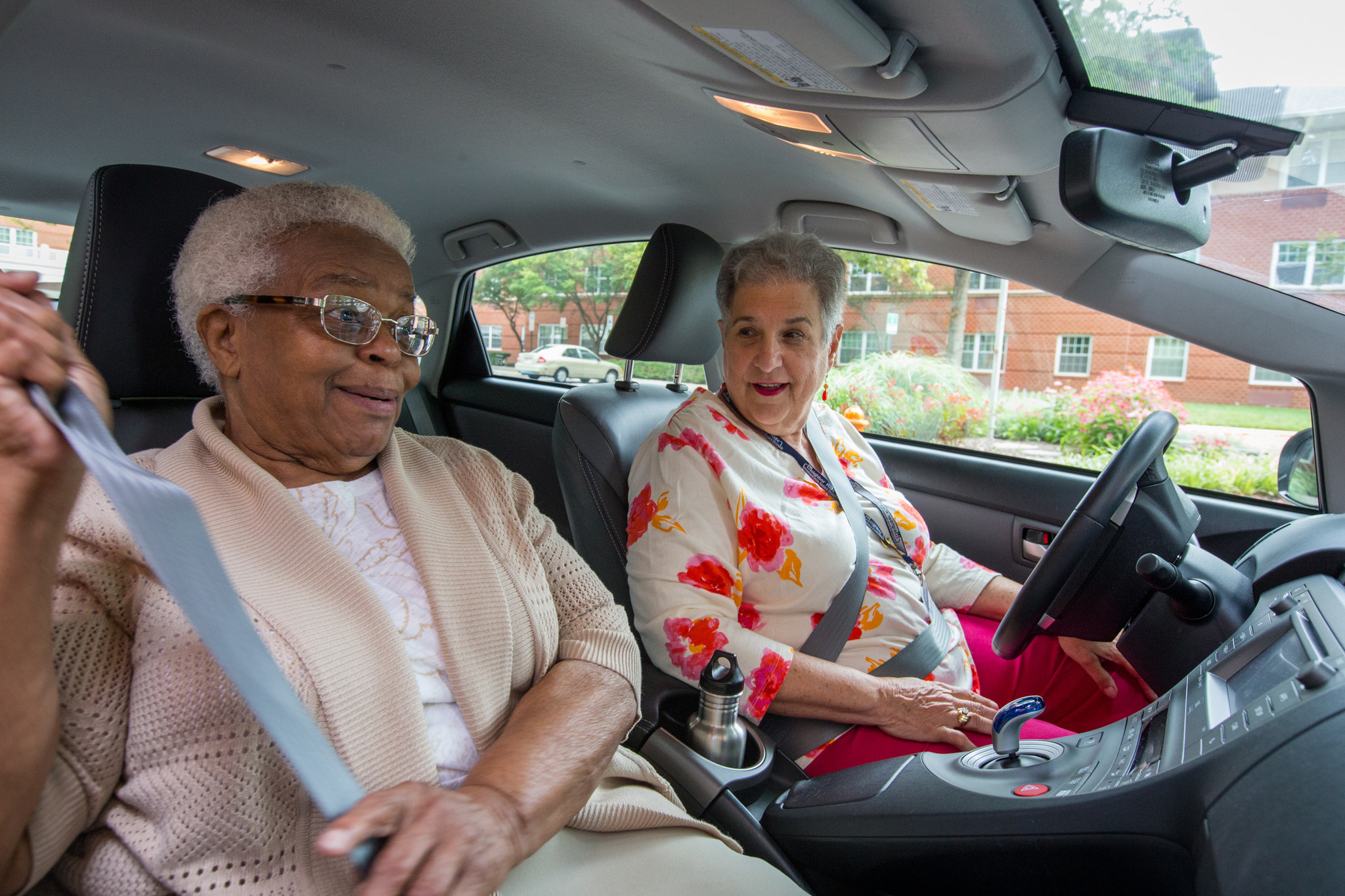 Columbia senior Mildred Jones, left, puts on her seat belt as Neighbor Ride volunteer driver Sue Sternheimer takes her to Sunday service at Columbia Community Church. Jones has used Neighbor Ride since 2005 to attend weekly services. Without family nearby, Jones says she values her talks with...