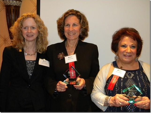 """Left to right: Anne Danaher, executive director of Jewish Family Services of Greater Hartford, presents Judy Rosenthal and Ellen Cartledge with the Connecticut Council of Family Service Agencies' """"Family Champion 2014"""" awards."""