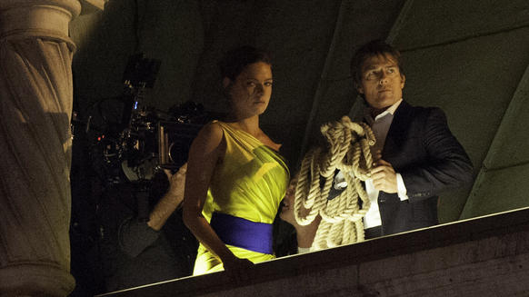 "Rebecca Ferguson and Tom Cruise on the set of ""Mission: Impossible 5"" on the roof of the opera house in Vienna."