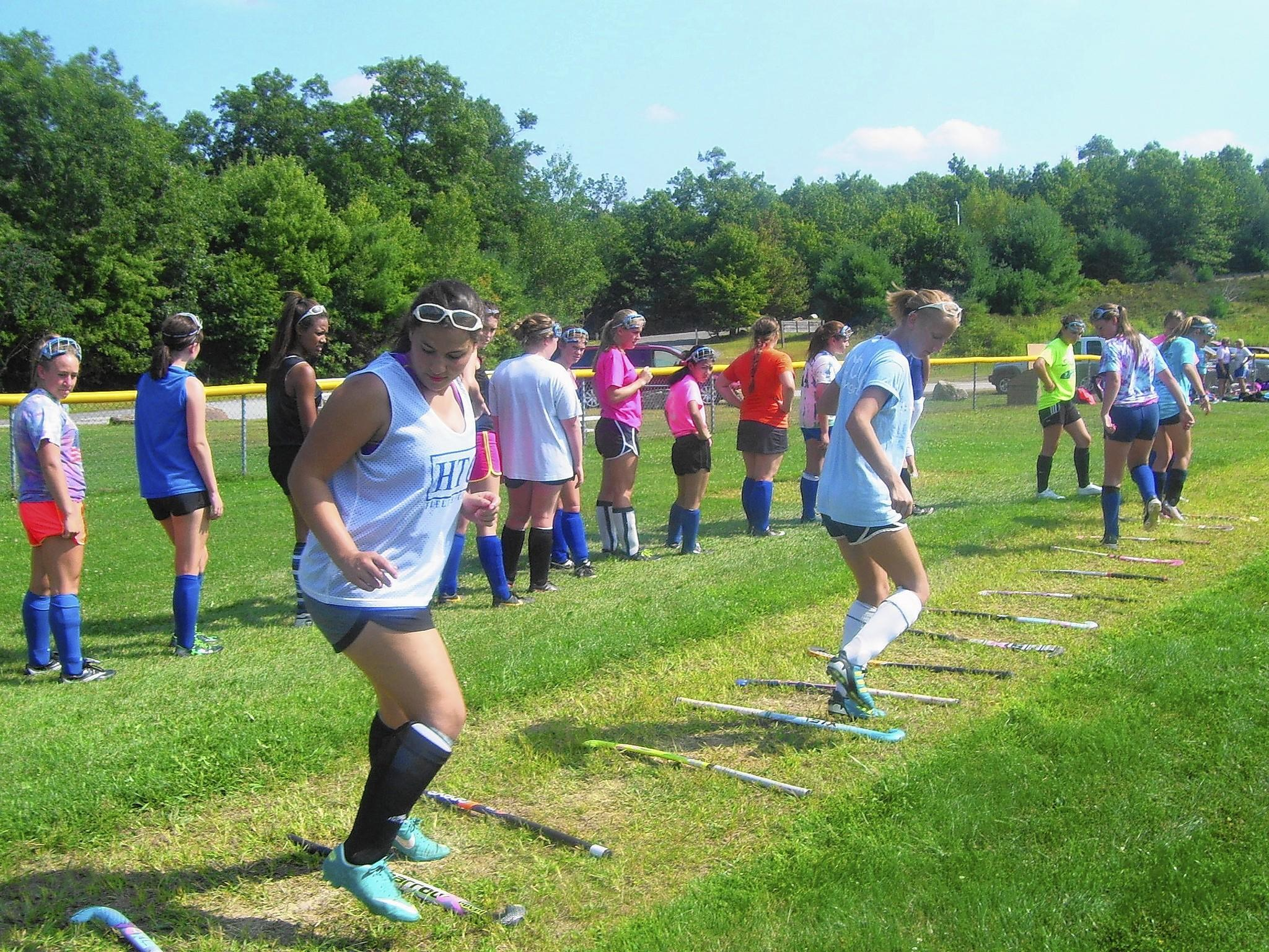 The field hockey team at Stafford High School ran through a series of drills after classes on the first day of school. Photo by Annie Gentile.