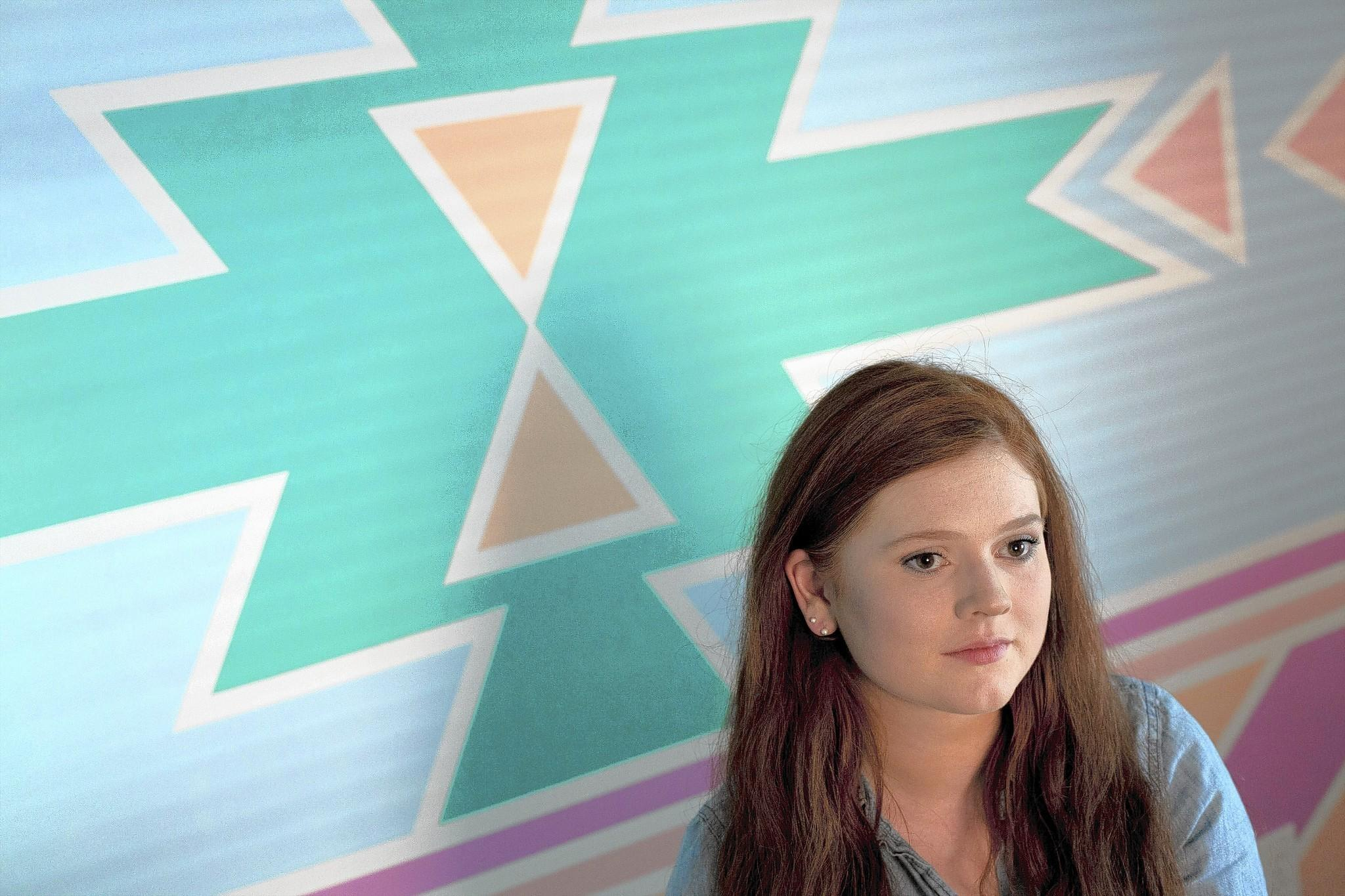 Corinna Henderson in her home studio in Hampton, with a southwest-inspired wall she taped and painted, on August 13, 2014. Henderson won third place in the fourth annual DIY Frog Tape competition and took home a prize of $1,000.