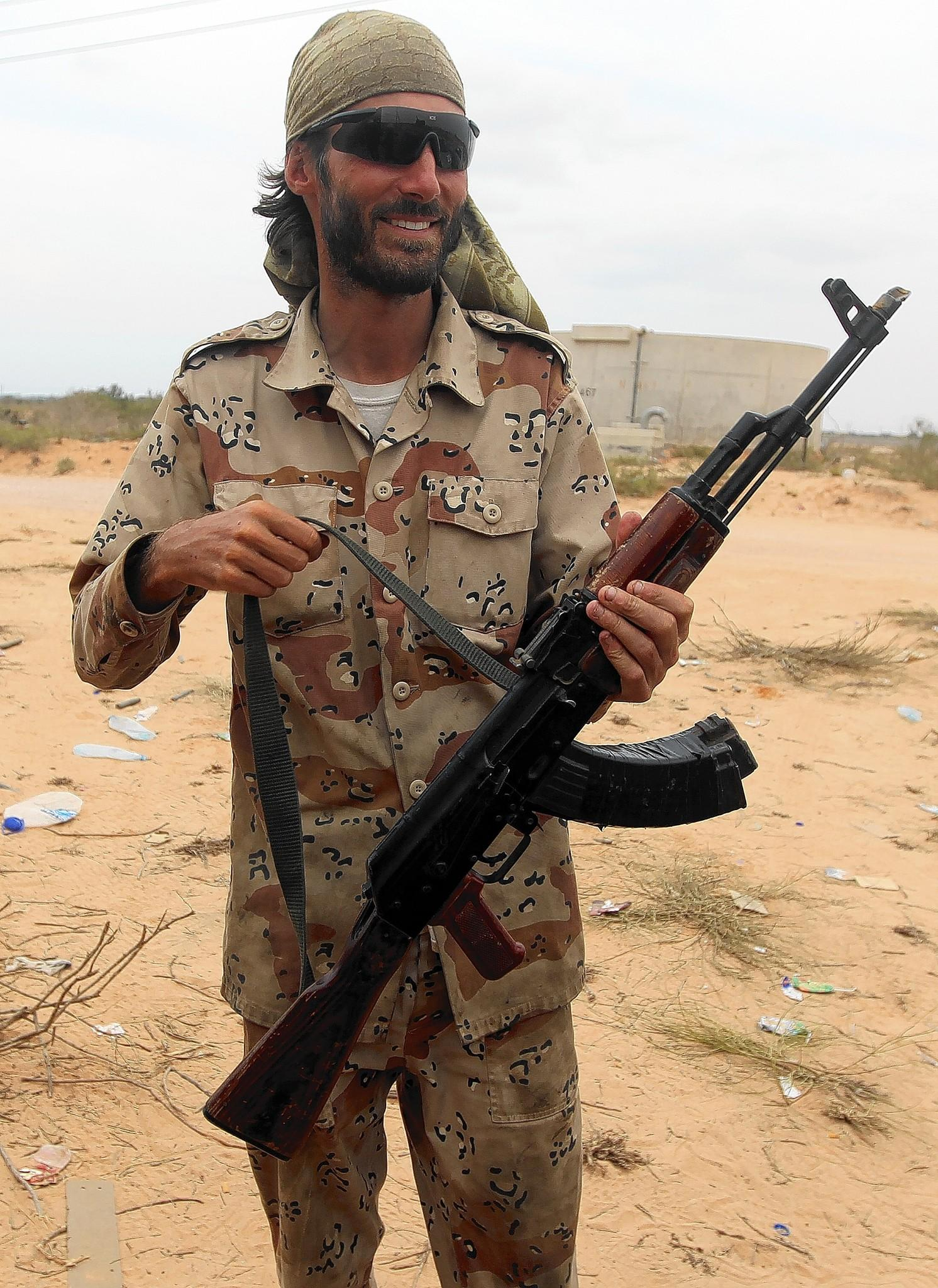U.S. national Matthew VanDyke holds his gun at the eastern front to the city Sirte on Oct. 2, 2011. VanDyke, from Baltimore, was held by Moamer Kadhafi's forces in Tripoli's dreaded Abu Salim prison for nearly six months before he escaped to join the Libyan rebellion against Kadhafi.