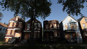 Chicago-area foreclosures drop 38% in first half of 2014