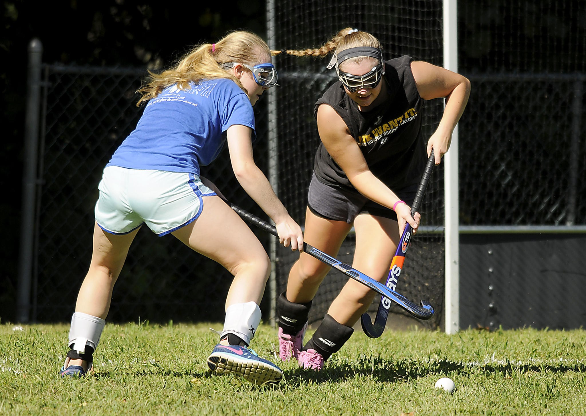 (L to R) Rylee Clarkin and Natalie Heaney battle for control of the ball as the East Catholic field hockey team practiced Wednesday afternoon in preparation for teir first game as a varsity program.