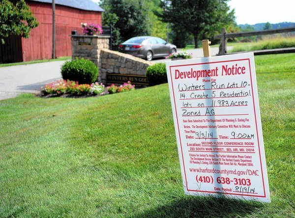 Bel Air golf club officials urged to move or protect historic house, landmark red barn