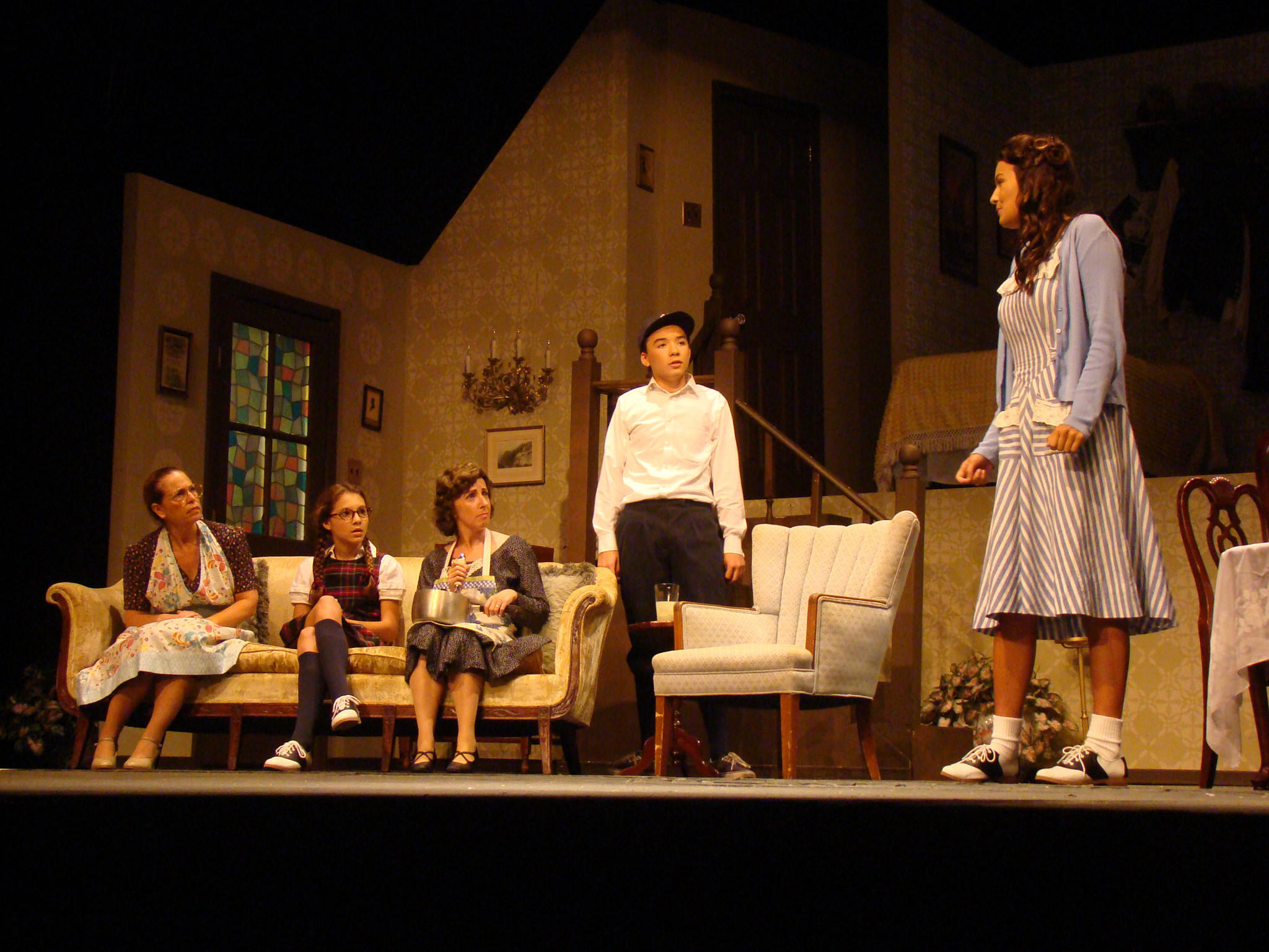 "From left: Jill Goodrich as Blanche Morton, Annalie Ellis as Laurie Morton, Nora Zanger as Kate Jerome, Casey Baum as Eugene Jerome and Sophie Speciale as Nora Morton in ""Brighton Beach Memoirs,"" on stage at the Bowie Playhouse through Sept. 13. Photo by Bud Johnson, for The Baltimore Sun"