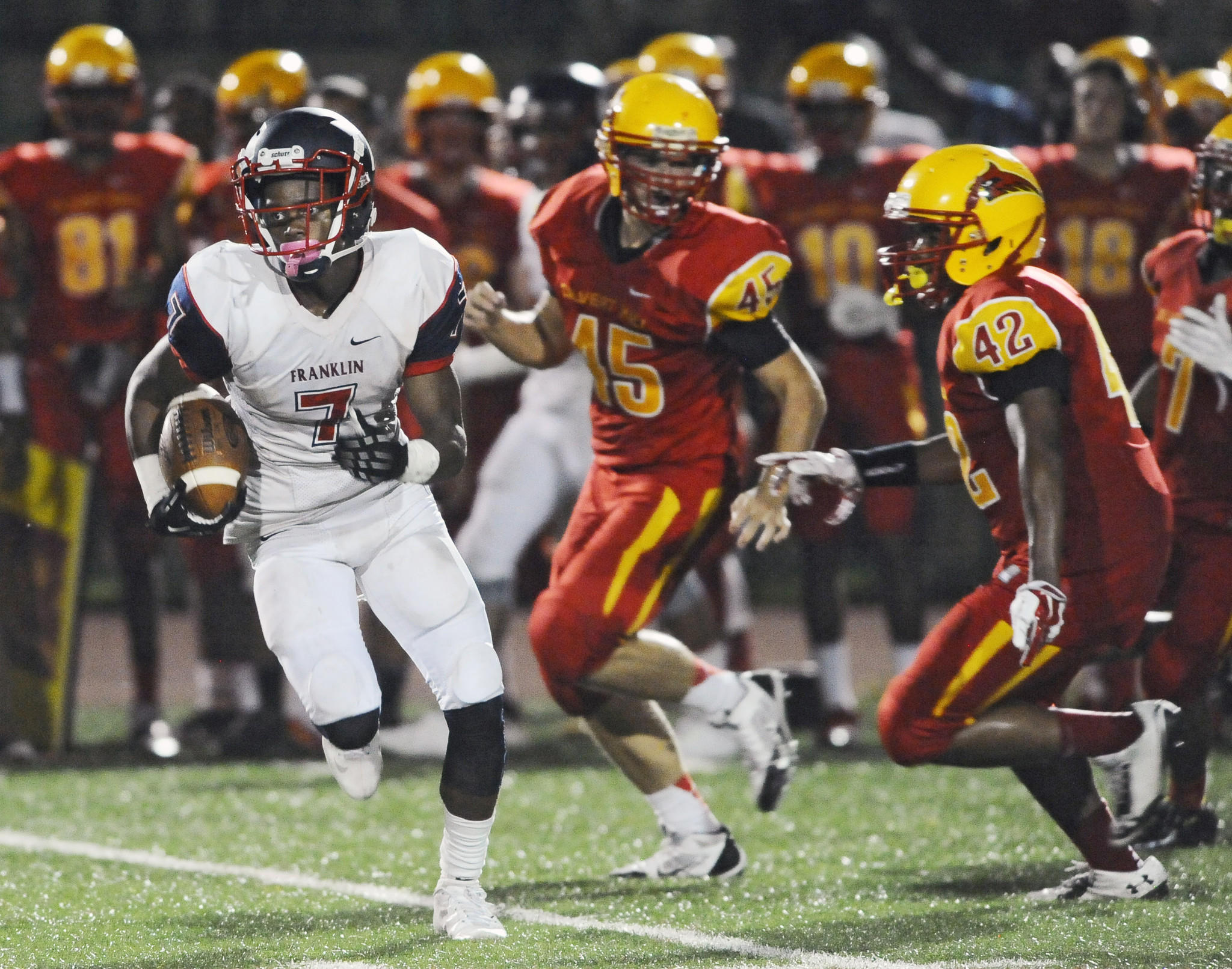 Franklin's Steven Smothers outruns Calvert Hall's Jared Wegrzyn (45) and Nick Booker (42) to return a punt 93 yards for touchdown in the third quarter. Calvert Hall defeated Franklin, 35-24.