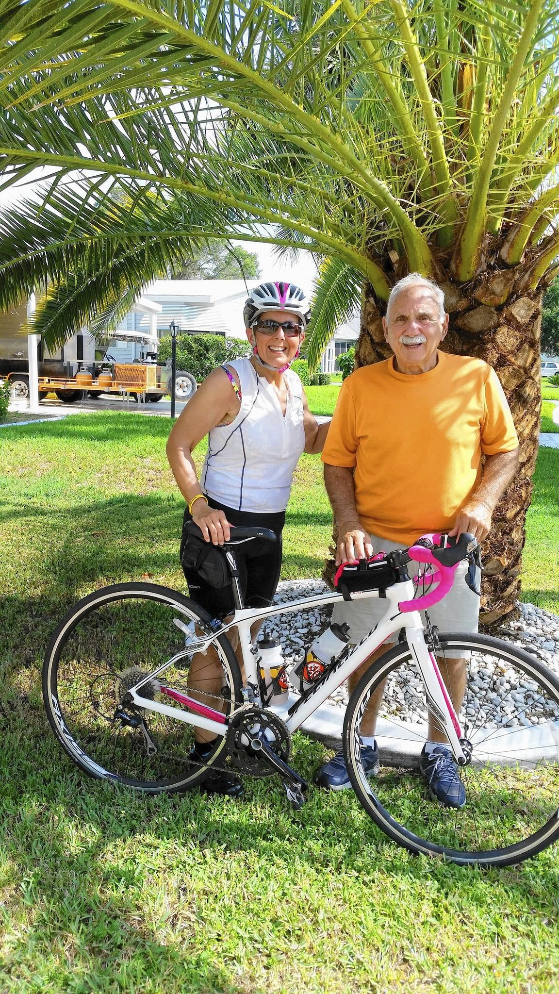 Cathy Teodosio of Fells Point, shown on a visit to Florida with her father Joseph Teodosio, is training for the Sept. 13 Ride to Conquer Cancer.