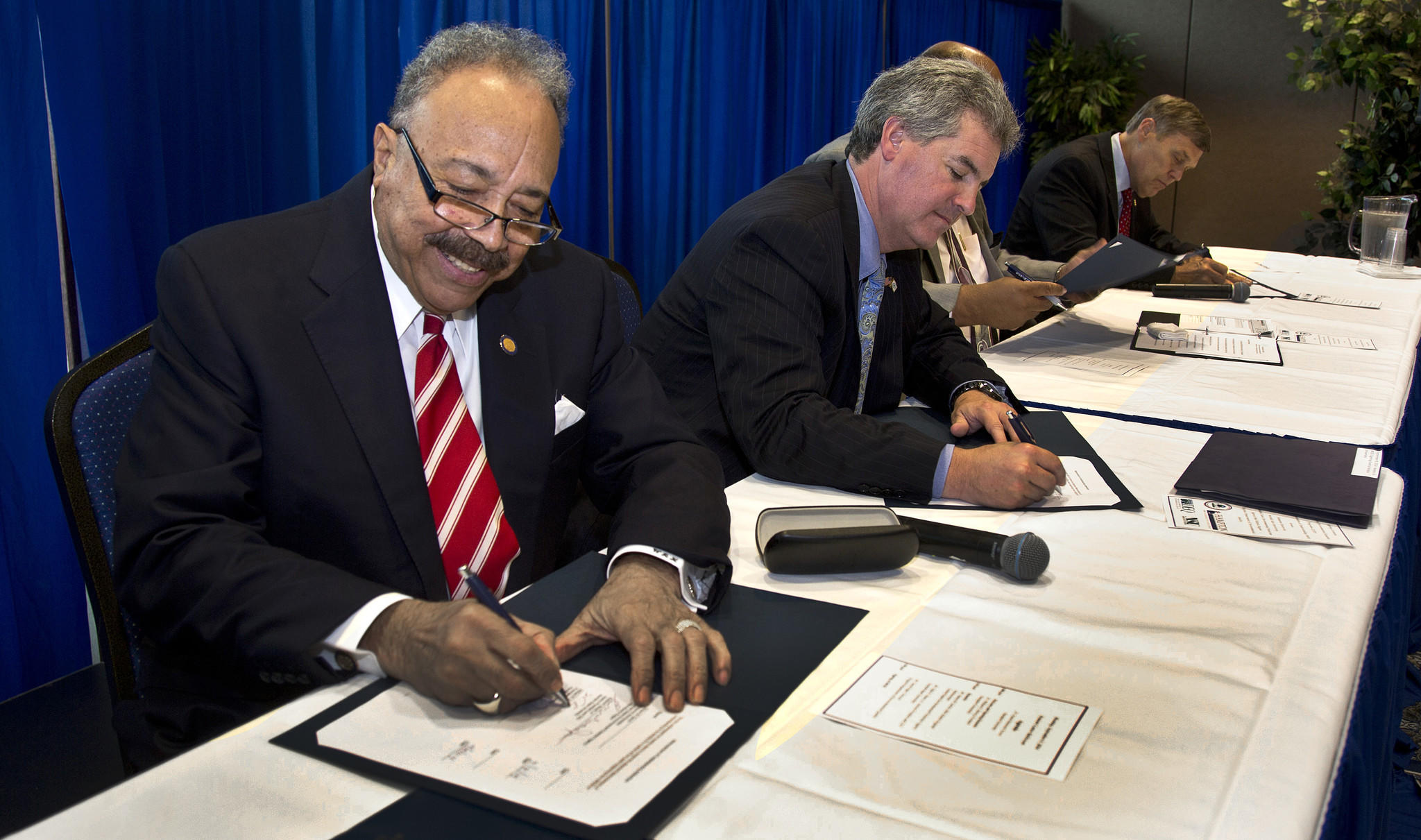 "Hampton University, Norfolk State, DEQ and the EPA announce a new initiative that will boost minority involvement in STEM Fields and ""green"" jobs. Pictured signing a memorandum of understanding: Left to right, Dr. William R. Harvey, Hampton University President; Shawn M. Garvin, Mid-Atlantic Regional Administrator for the EPA; Eddie N. Moore, Norfolk State interim president; and David Paylor, director of the Virginia Department of Environmental Quality."