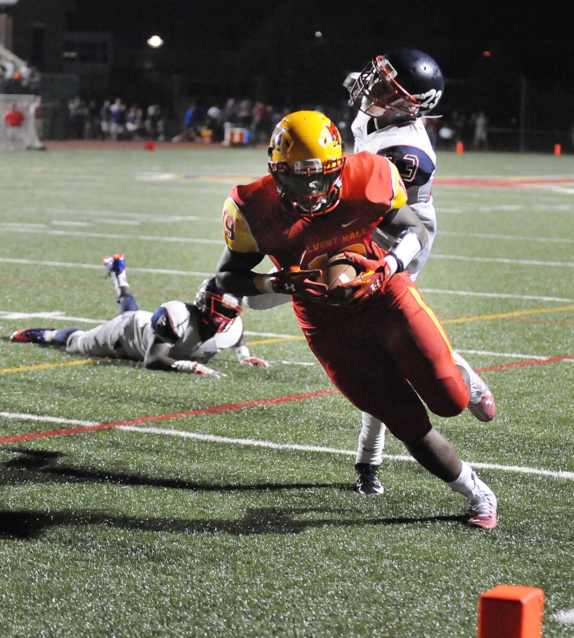 Calvert Hall's Timothy Smith evades Franklin's Jordan Adams to score the go-ahead touchdown in the fourth quarter.