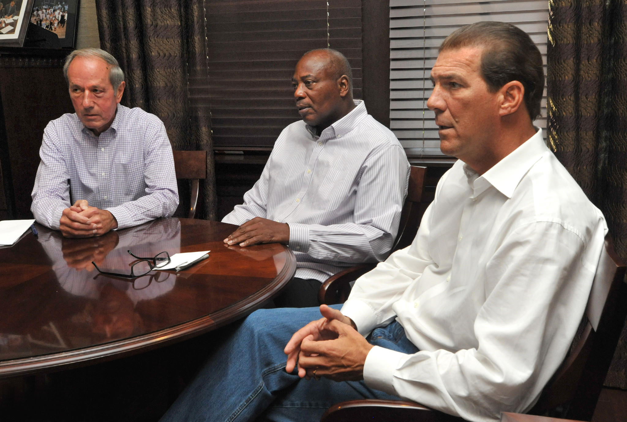 Ravens team executives from the left, president Dick Cass, general manager Ozzie Newsome and owner Steve Bisciotti sit down with The Baltimore Sun Wednesday at the Ravens' complex.