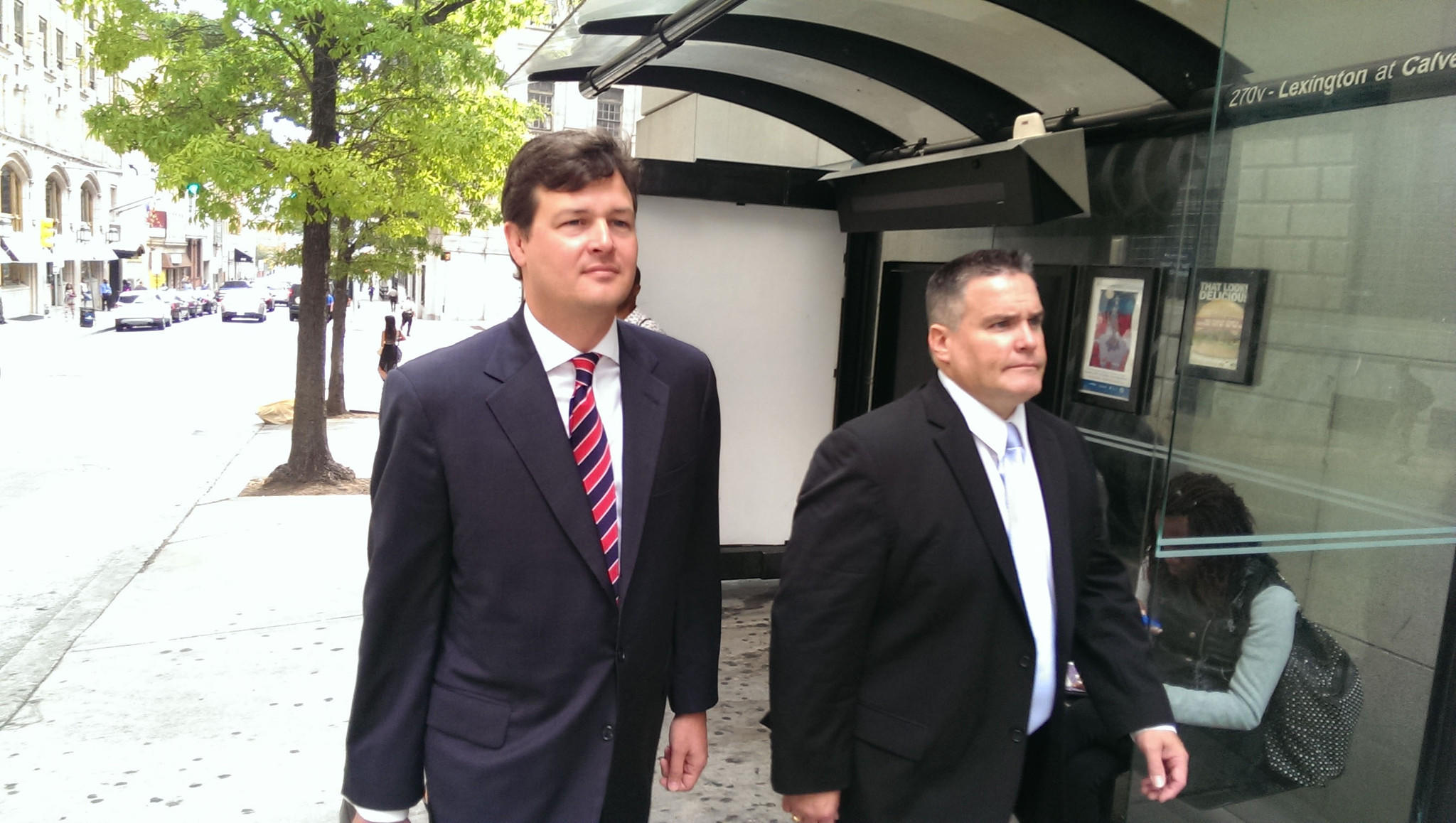 Baltimore Police Agt. Jeffrey Bolger (right) leaves court with one of his attorneys after pleading not guilty to animal mutilation and animal cruelty charges in the death of shar-pei Napa in June.