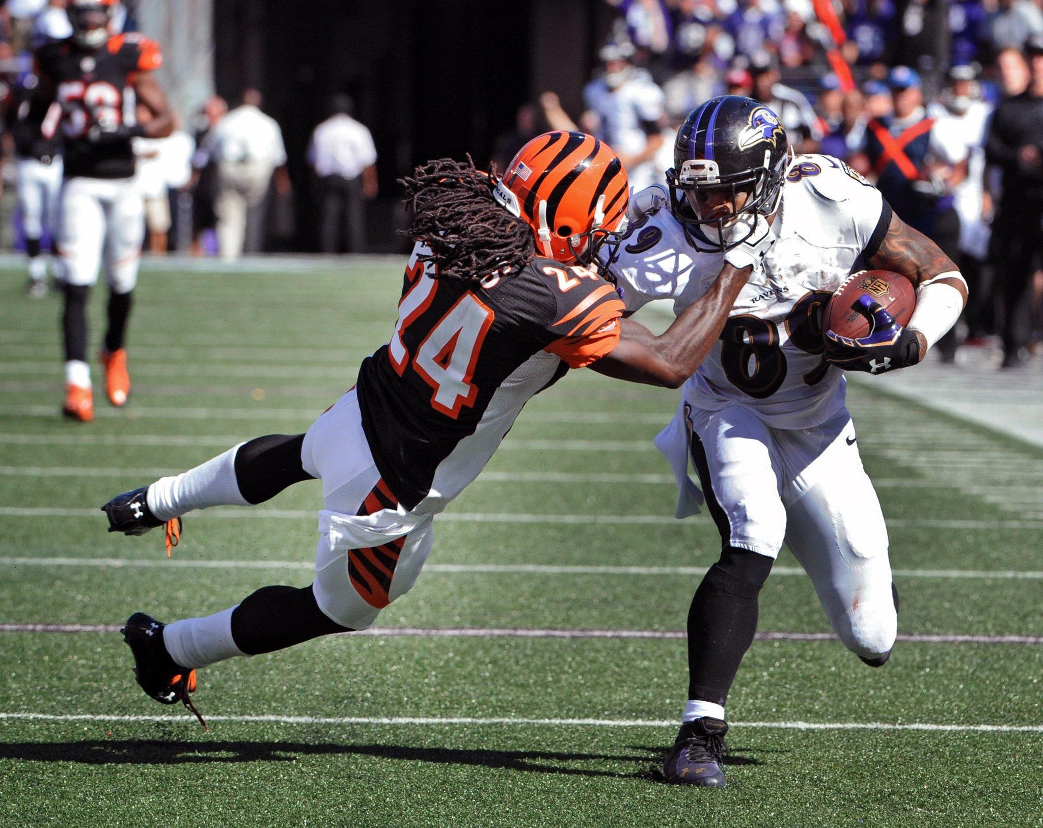 Ravens wide receiver Steve Smith Sr. throws down the Bengals' Adam Jones on the way to the end zone for an 80-yard touchdown.