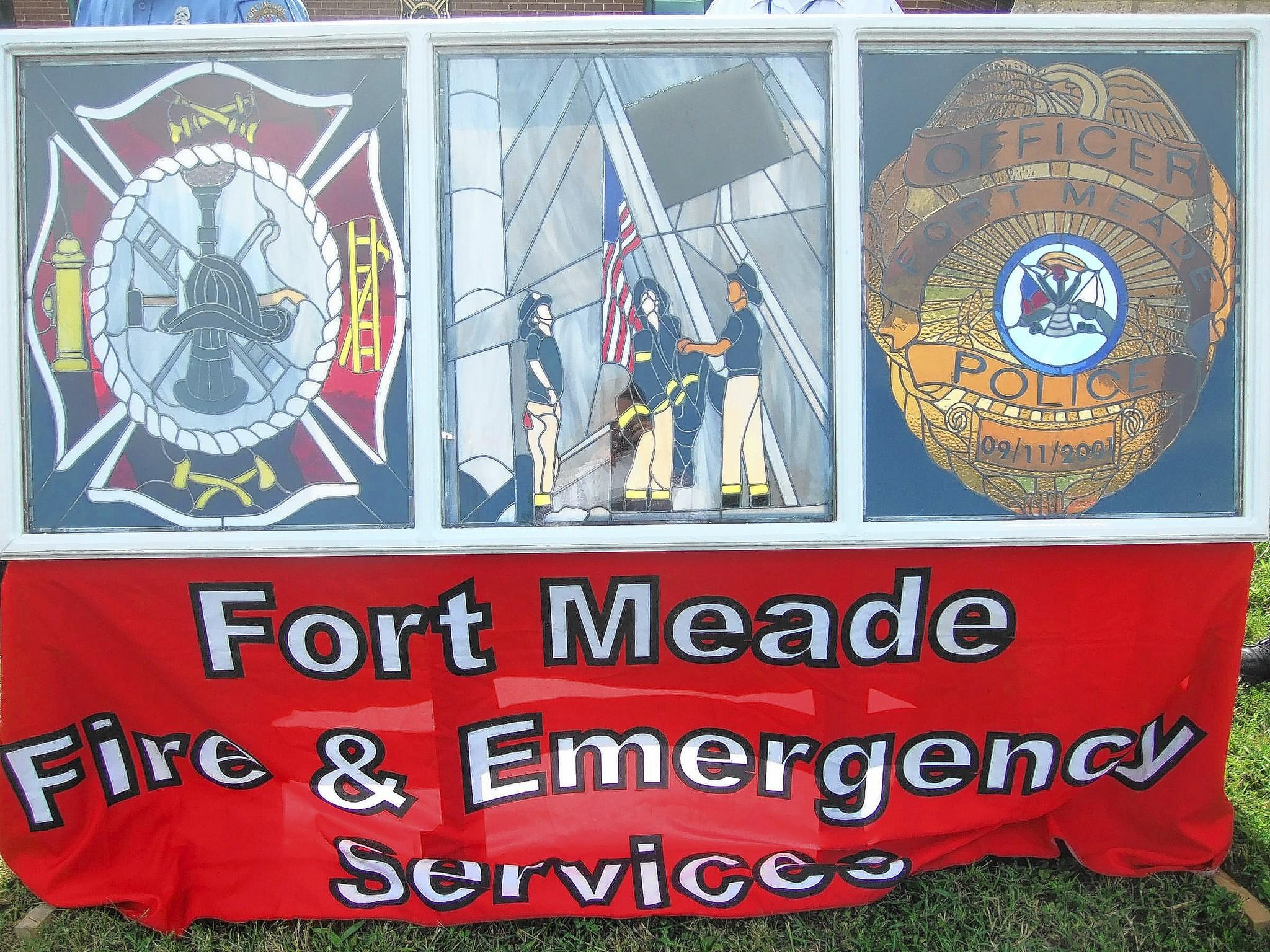 At a ceremony on Sept. 11 at Fort Meade, members of the base's Directorate of Emergency Services were presented with a stained glass image honoring first responders. The work featured a piece of metal from the World Trade Center (center panel, to the right of the flag) that was given to the department by a police officer who responded to the attacks on 9/11