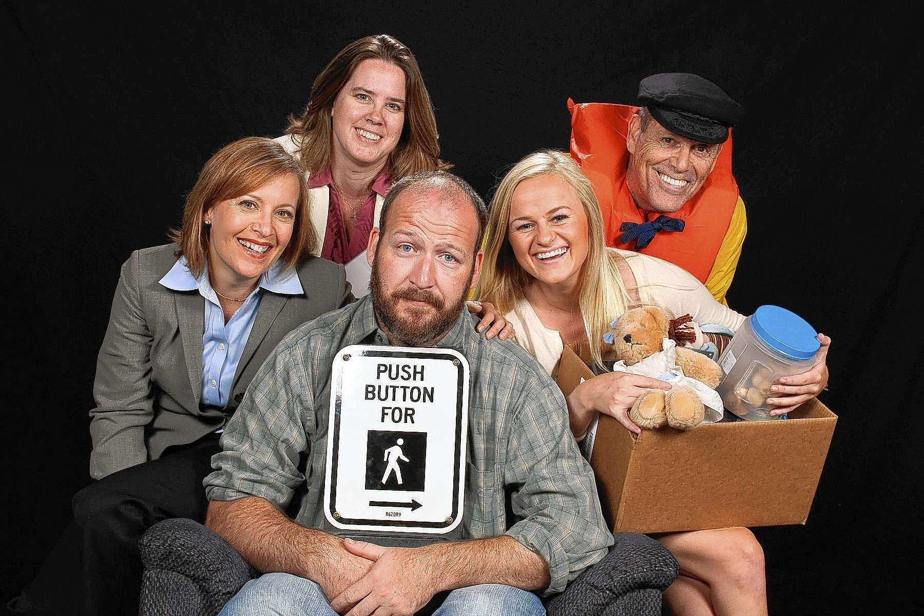 "Ben Carr, clutching his pedestrian walk button box, is surrounded by other ""Rocket Man"" cast members Laura Gayvert, Shirley Panek, Paige Miller and Tim Sayles. ""Rocket Man,"" runs Sept. 5-27 at Colonial Players theater in Annapolis."