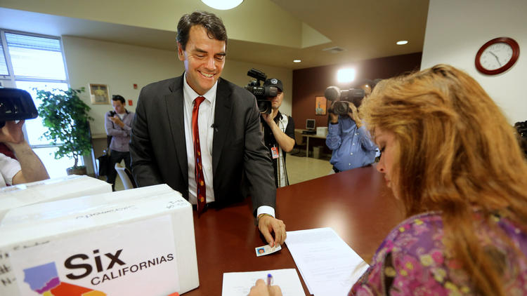 Tim Draper, seen here in 2014 submitting signatures on his plan to split California into six separate states. The measure failed to qualify for the ballot. (Rich Pedroncelli/Associated Press)