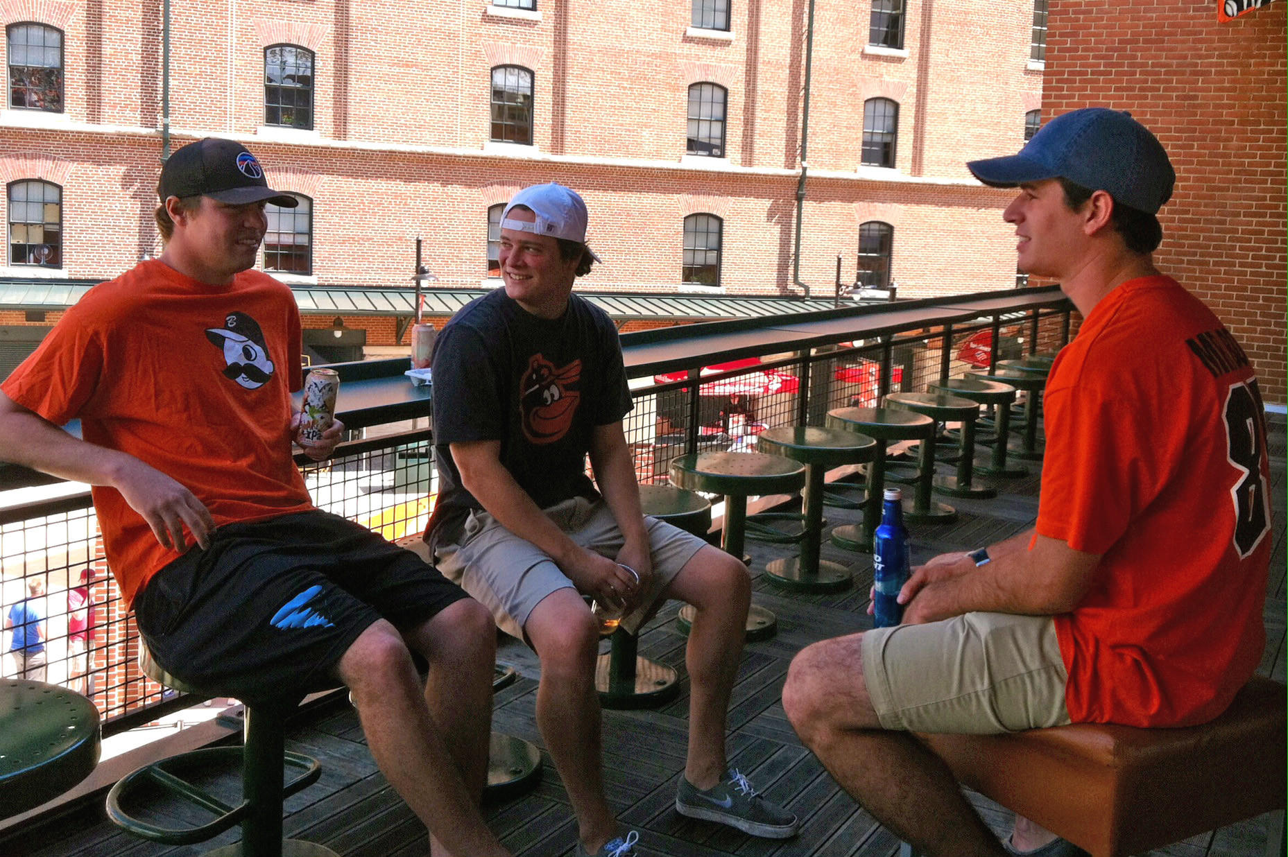Orioles fans, from left, Andy Barton, Sean Wey and Pat Powderly, hang out at the bar over the batter's eye at Oriole Park at Camden Yards during the first game of a double-header against the Yankees.