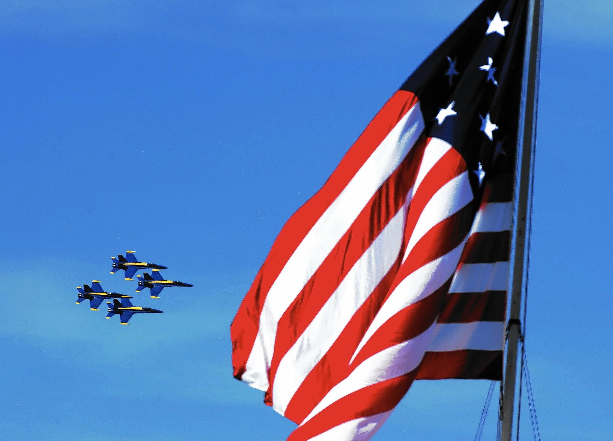 The U.S. Navy Blue Angels flight demonstration squadron fly their Boeing F/A-18 Hornets over the replica 1812 U.S. flag at Fort McHenry during a rehearsal for the Star-Spangled Spectacular Air Show