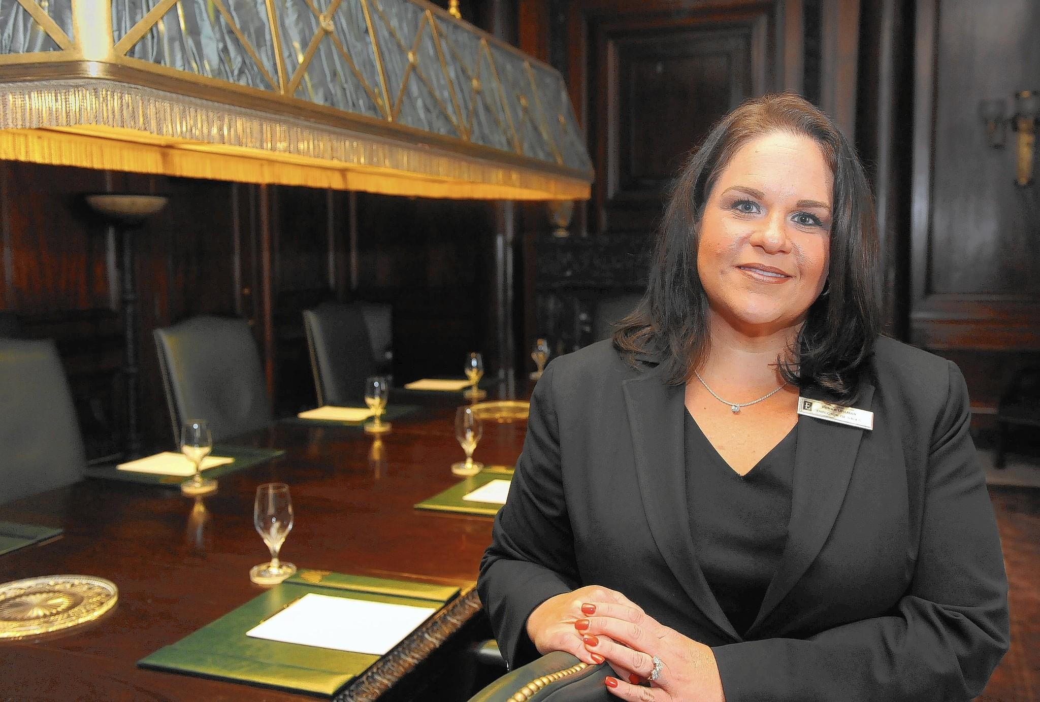 Renee Uhlman, director of sales and marketing at Embassy Suites Downtown Baltimore Inner Harbor, in the Board Room of the hotel.