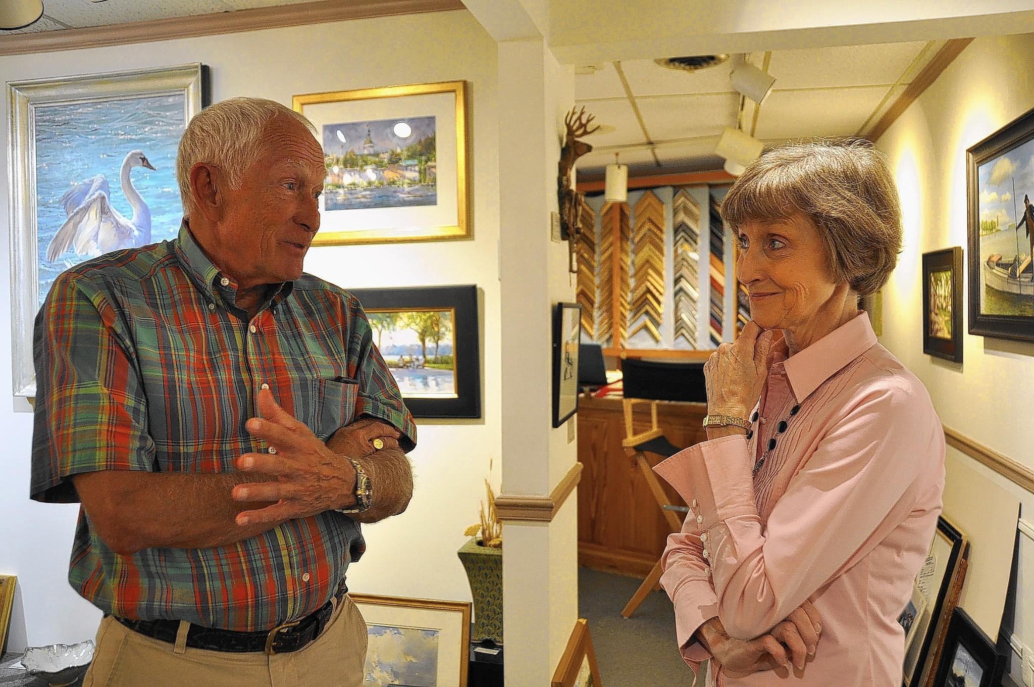 State Sen. John C. Astle stops in to visit Cynthia McBride at McBride Gallery on Main Street in Annapolis on Thursday. Astle is a Democrat, but he said he has taken some votes that appeal to business owners who tend to be more conservative or Republican.