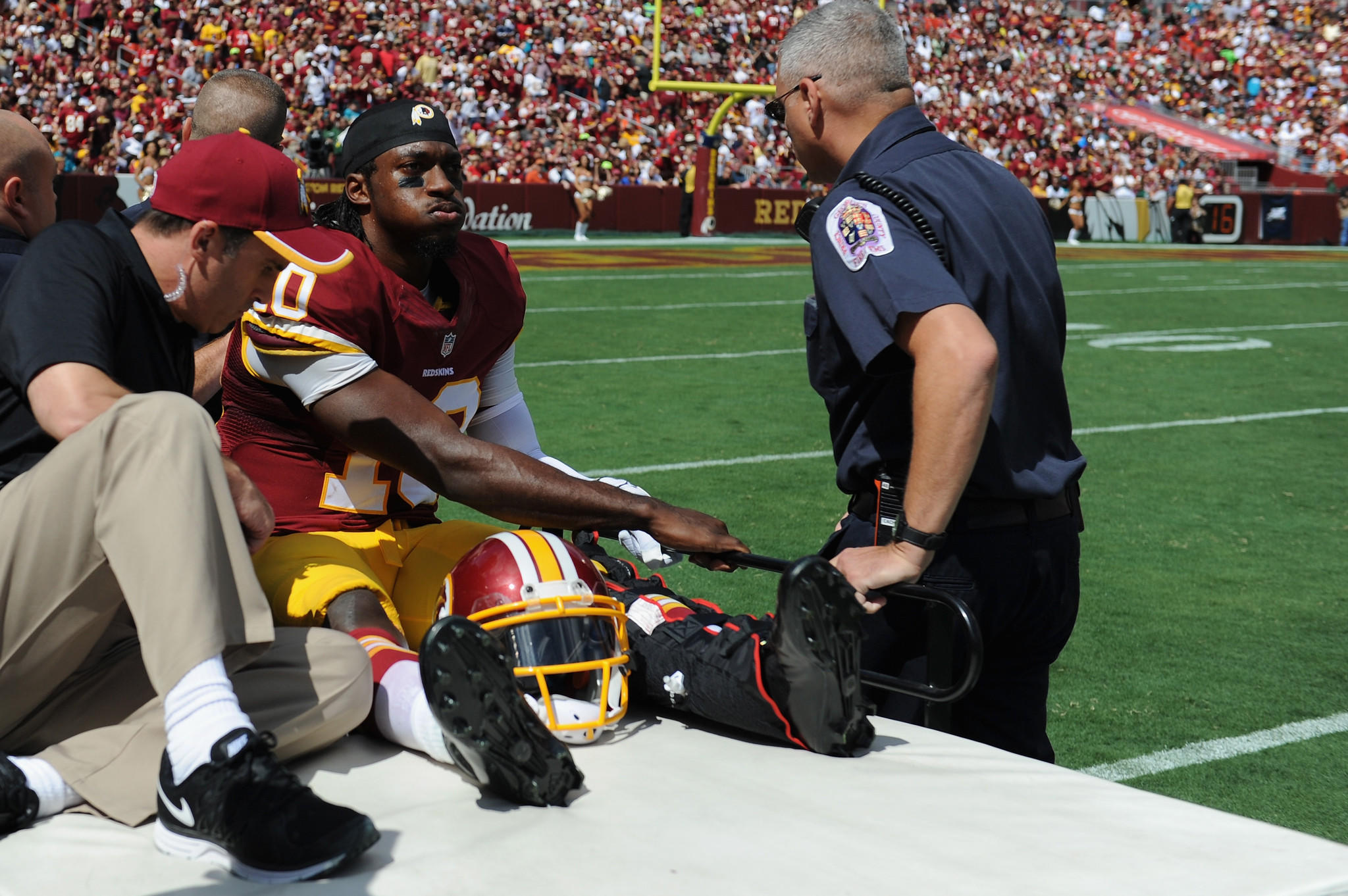 Quarterback Robert Griffin III #10 of the Washington Redskins is carted off the field after being injured during a game against the Jacksonville Jaguars at FedExField on September 14, 2014 in Landover, Maryland.