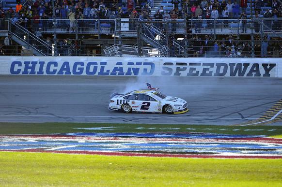 Sep 14, 2014; Joliet, IL, USA; NASCAR Sprint Cup Series driver Brad Keselowski (2) celebrates winning the MYAFIBSTORY.COM 400 at Chicagoland Speedway.