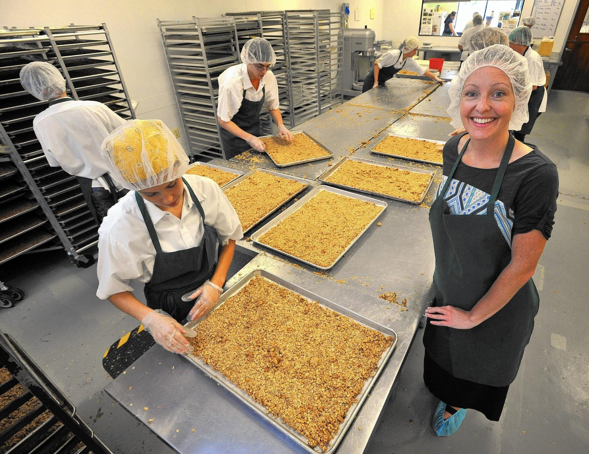 Michele Tsucalas, right, who founded Michele's Granola in 2006, has expanded to 28 employees, and will be at the Natural Products Expo East for the first time.