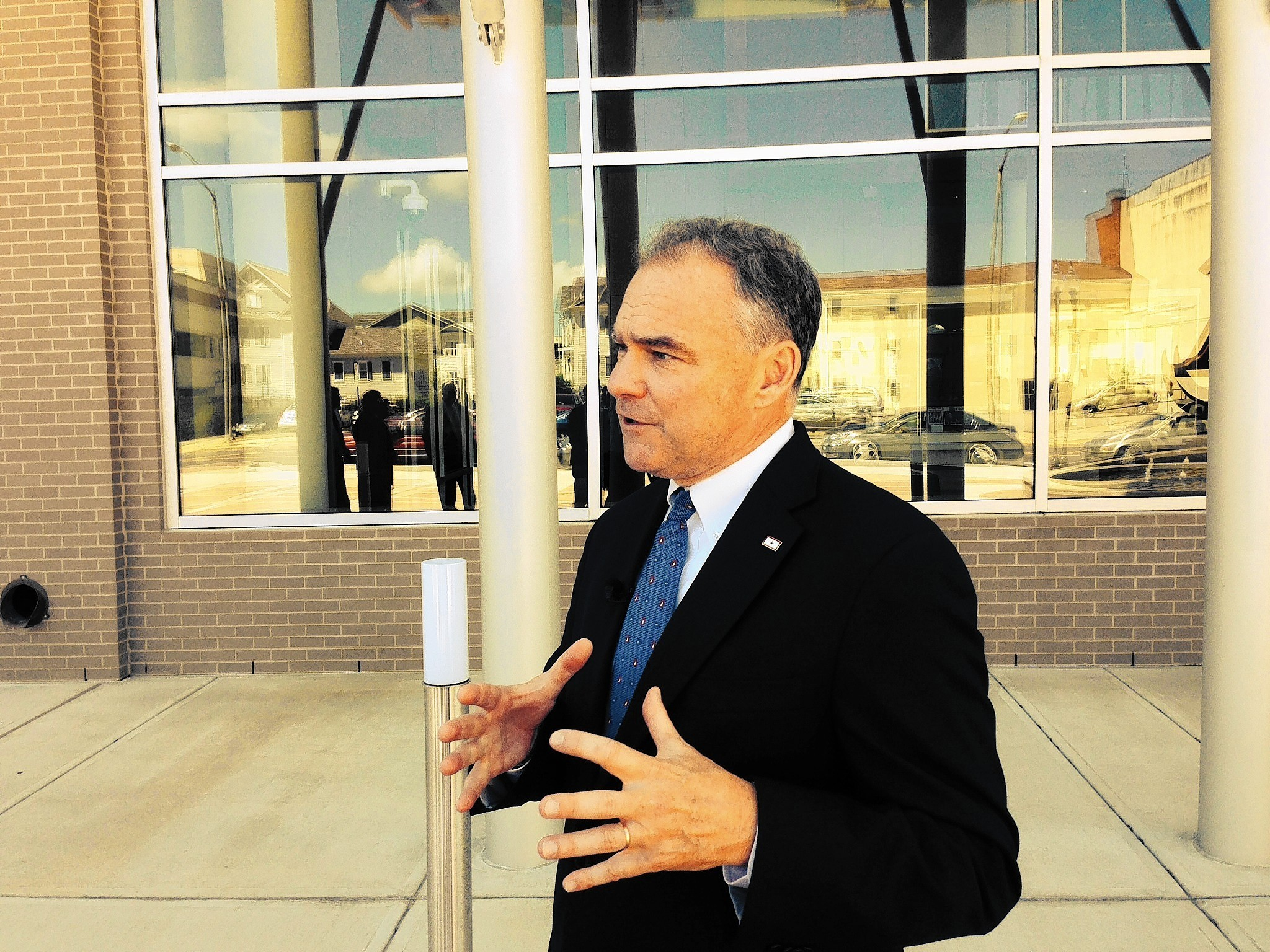 Sen. Tim Kaine, D-Va., talks with reporters outside The Apprentice School at Newport News Shipbuilding in August. Kaine toured the school and discussed how Congress could encourage more training and technical education.