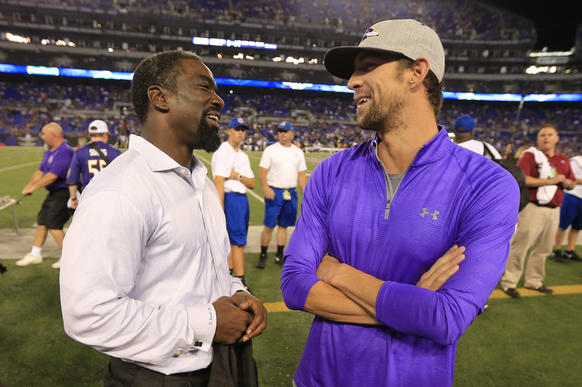 Former Ravens safety Ed Reed talks with Olympian Michael Phelps before a game between the Ravens and Pittsburgh Steelers at M&T Bank Stadium.