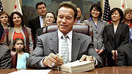 Schwarzenegger cuts $500 million more as he signs budget