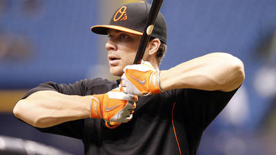 Suspended Orioles infielder Chris Davis helps at scene of bad accident Monday