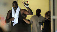 Shaq makes splash, then swims against Phelps