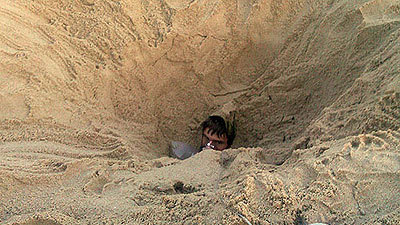 Image result for buried in sand at the beach