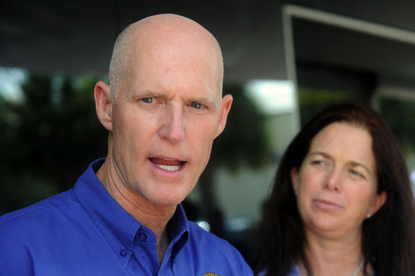 Gov. Rick Scott has called for state regulators to factor in Everglades concerns when considering a development proposal for 43,000 acres of sugar industry farmland south of Lake Okeechobee.