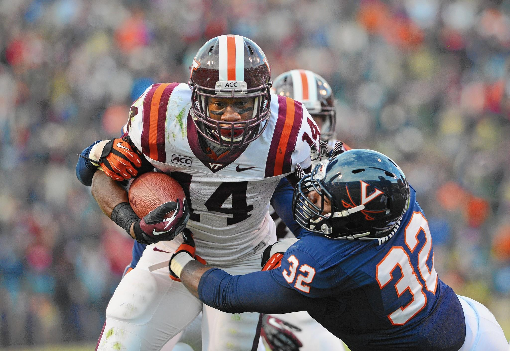 Virginia Tech's Trey Edmunds runs against Virginia during the Hokies' win in November 2013.