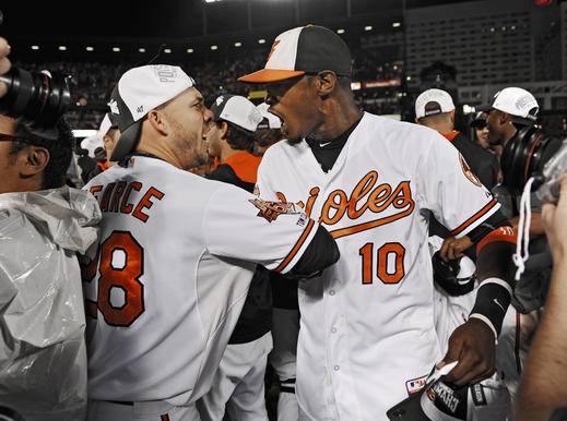 Orioles' Steve Pearce, left, celebrates with Adam Jones on the field after the Orioles clinched the American League East.