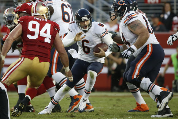 Bears quarterback Jay Cutler avoids the pass rush of 49ers defensive end Justin Smith and the defense and runs for 25 yards and a first down in the second quarter at Levi's Stadium.