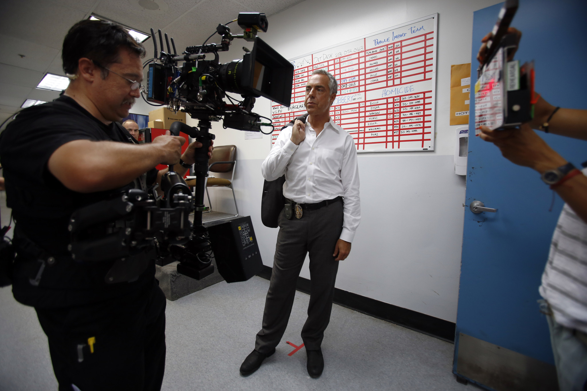 Steady cam operator Kenji Luster, left, and actor Titus Welliver, who plays Det. Harry Bosch, work on set in Hollywood.
