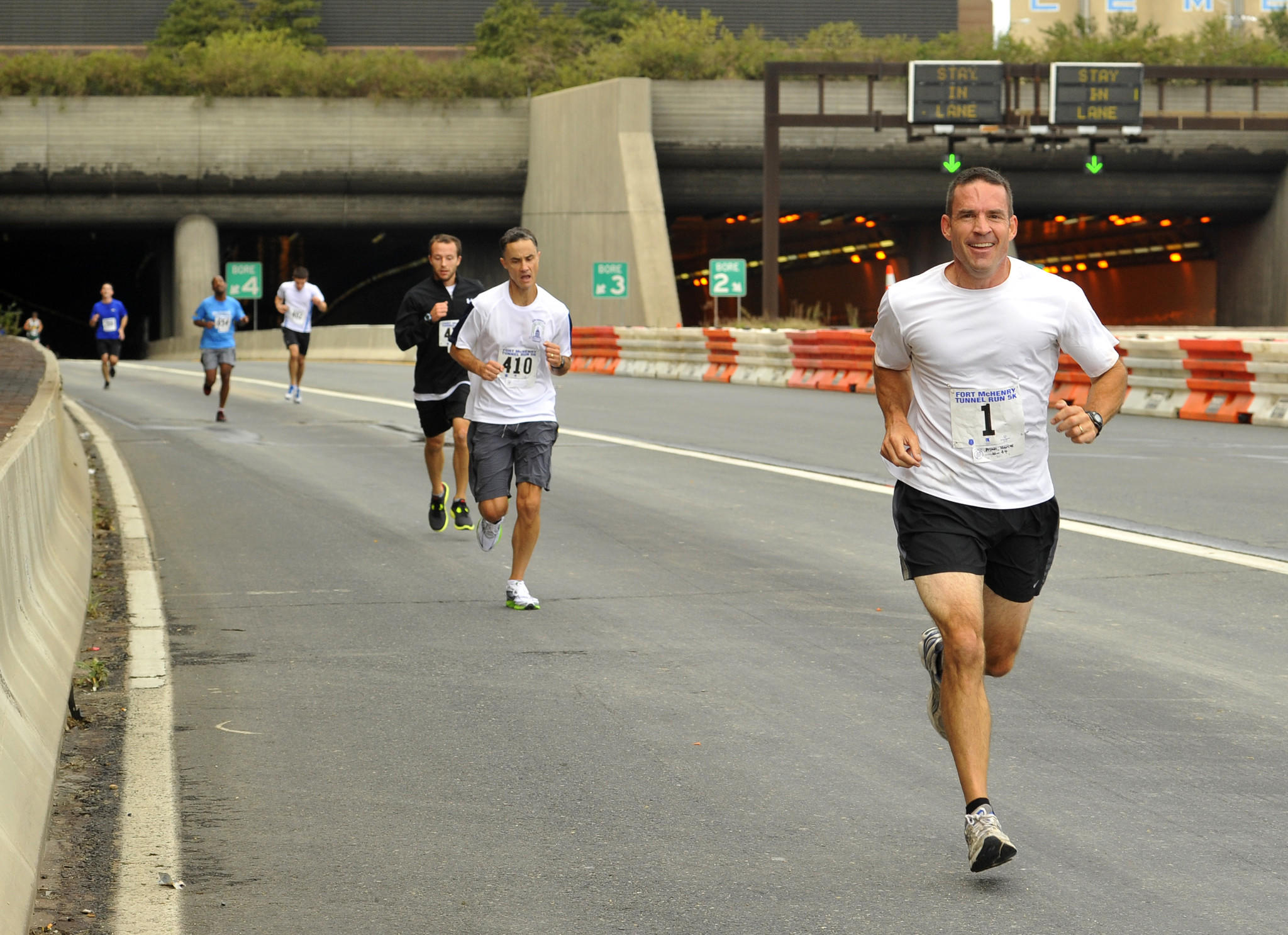 Marcus Brown, 47, Secretary of the Md. State Police, runs in the third annual Fort McHenry Tunnel 5K Run/Walk in 2011.