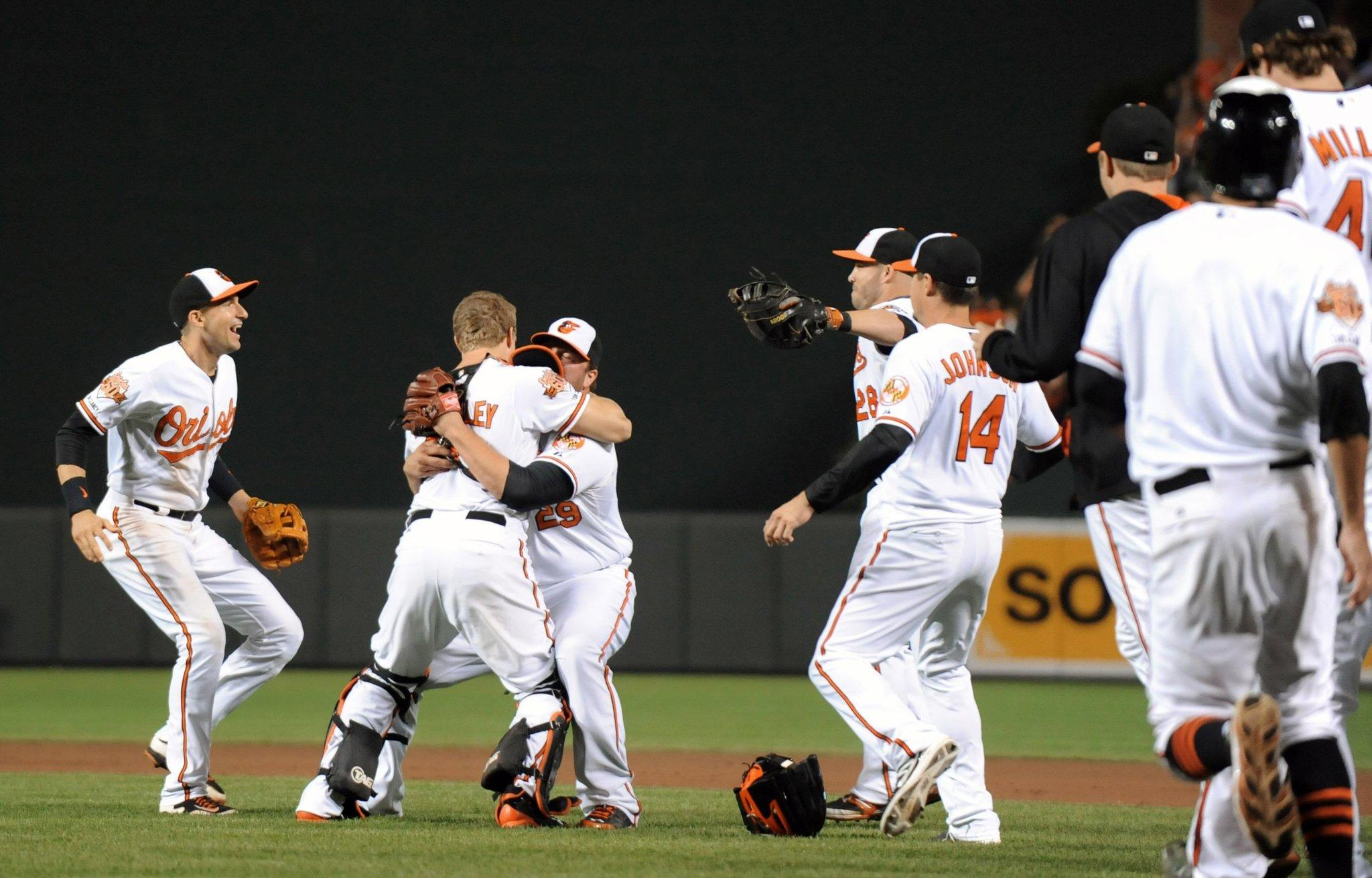 The Baltimore Orioles celebrate after defeating the Toronto Blue Jays, 8-2, to clinch the American League East division at Oriole Park at Camden Yards in Baltimore on Tuesday, Sept. 16, 2014.