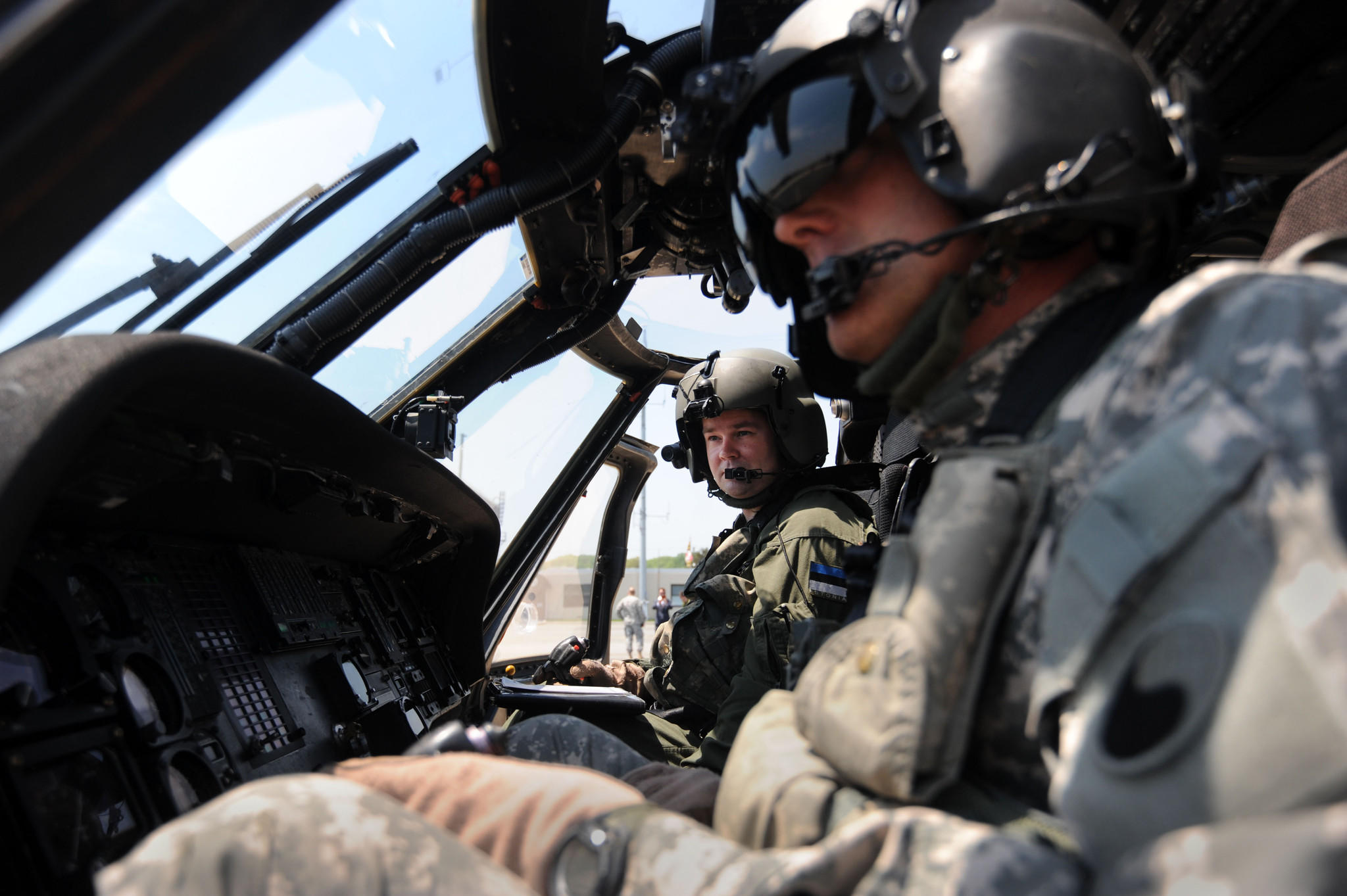 Left to right, CPT Martin Noorsalu of the Estonian Air Force and Chief Warrant Officer 5 David Eppler of the Maryland National Guard go through post-flight procedures after Noorsalu lands a UH-60, Black Hawk helicopter at the Weide Army Airfield.