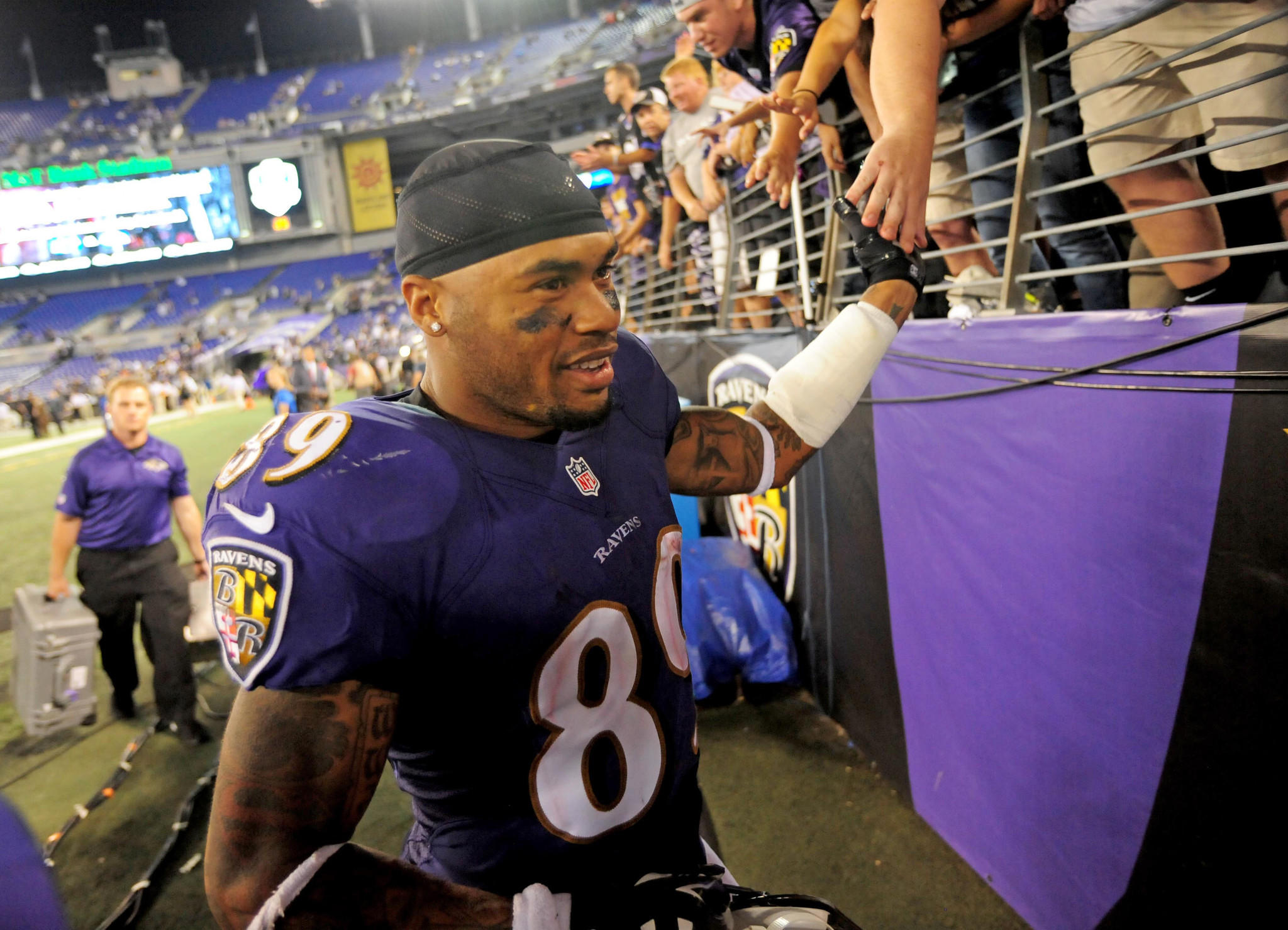 Ravens wide receiver Steve Smith Sr. high fives fans after beating the Pittsburgh Steelers 26-6 at M&T Bank Stadium.
