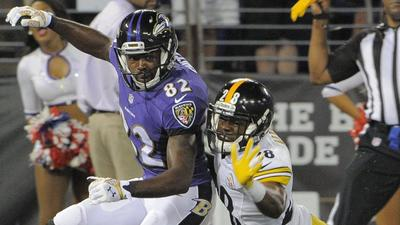 Torrey Smith says he's not frustrated by early lack of touches in Ravens' offense