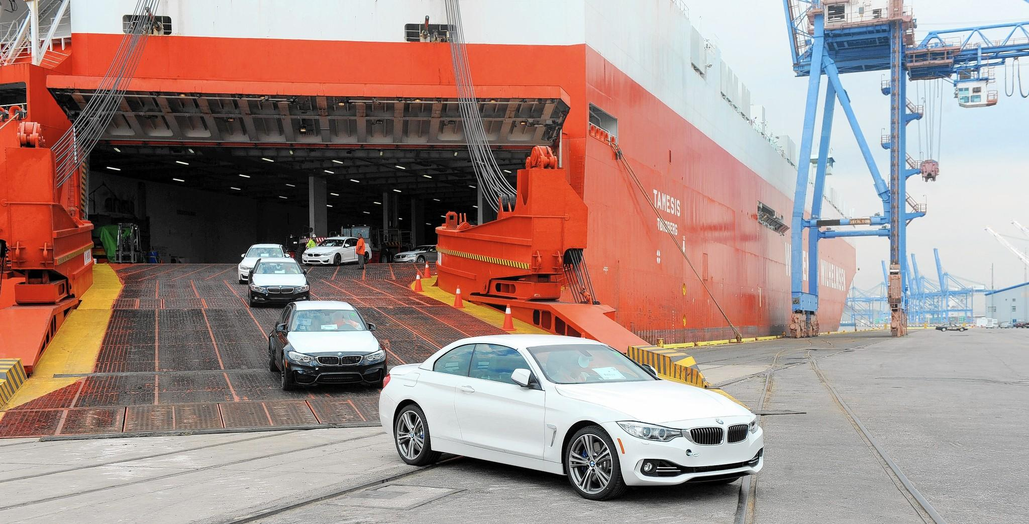 BMWs are driven off a Wallenius Wilhelmsen ship at the Port of Baltimore. BMW officially opens a new Vehicle Distribution Center at the port.