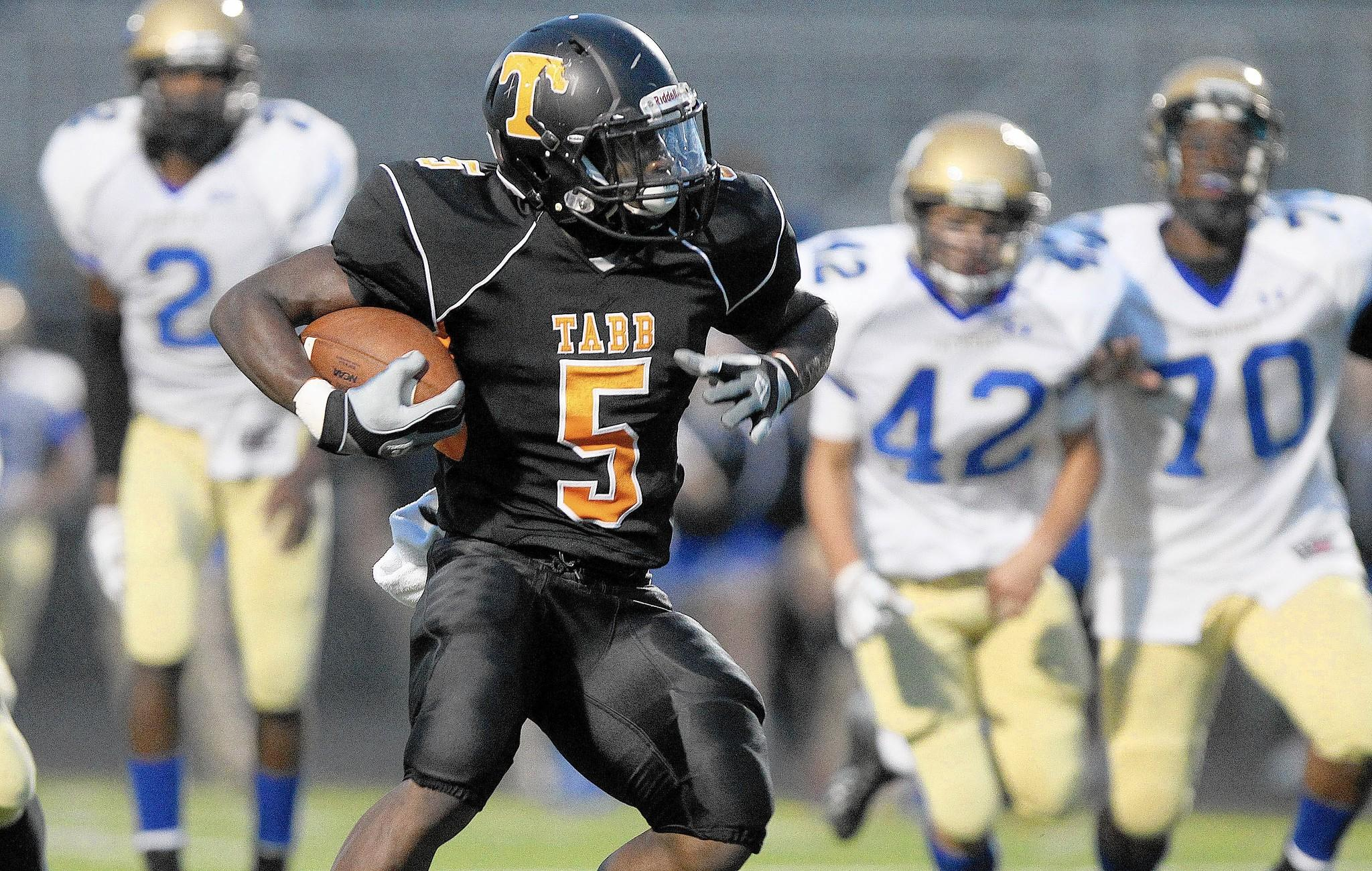 Antwuan Hicks of Tabb gets away from the Smithfield defense for a first quarter touchdown Thursday at Bailey Field.