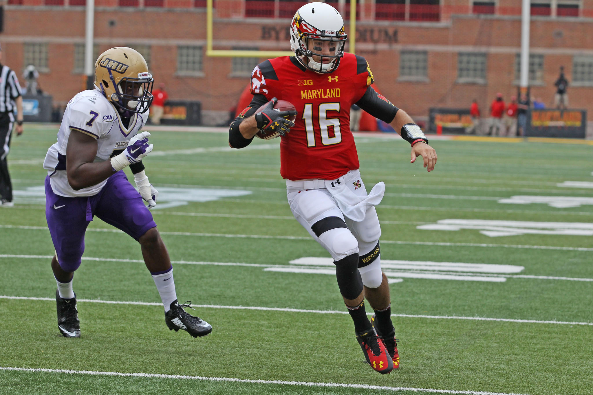 Maryland quarterback C.J. Brown runs past James Madison Dukes linebacker Rhakeem Stallings in the Terps' first game of the season.