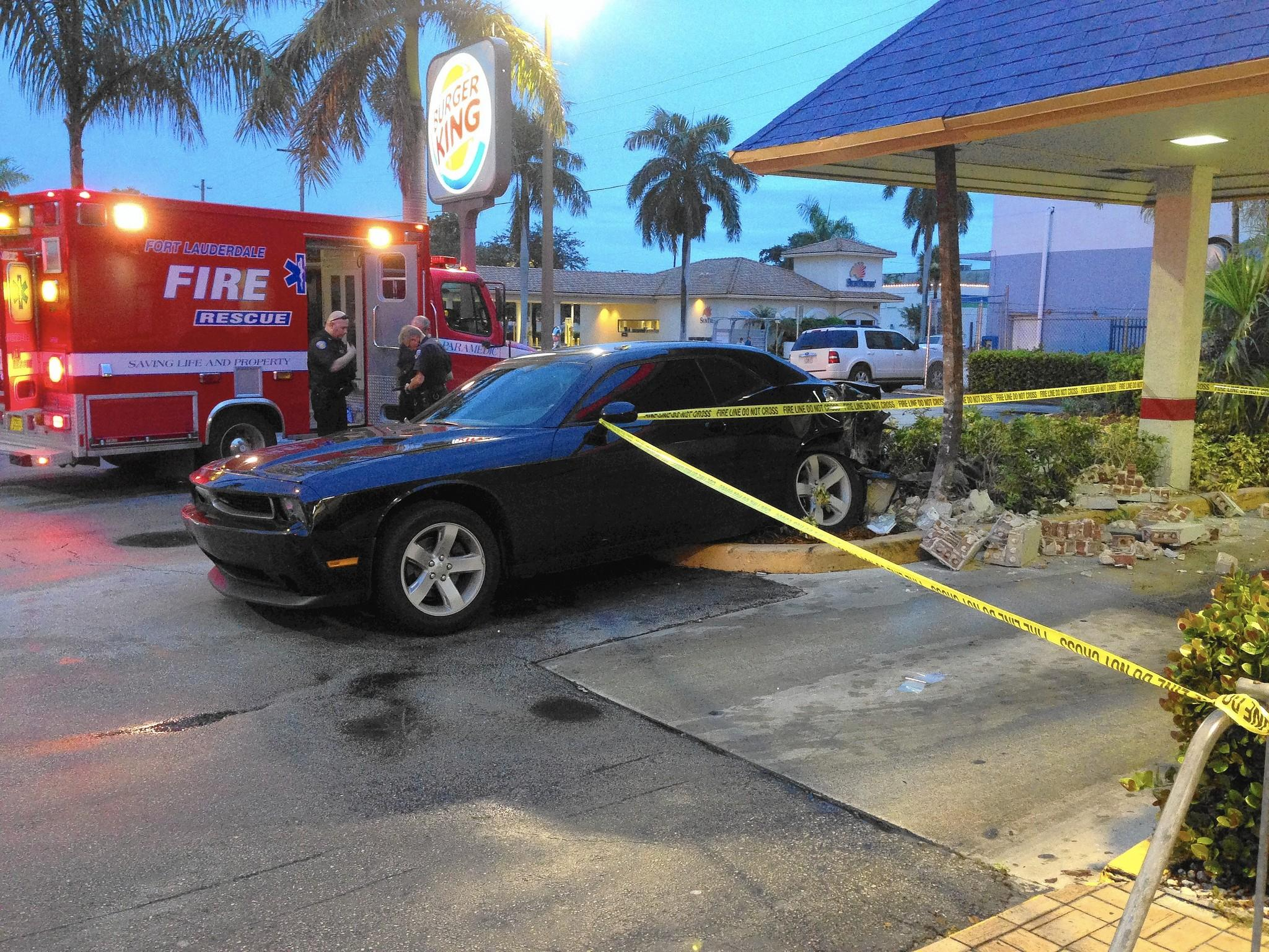 A man was treated for minor injuries Friday night after he crashed into a pickup and then backed into a column holding up the roof of a Burger King drive-thru in Fort Lauderdale.