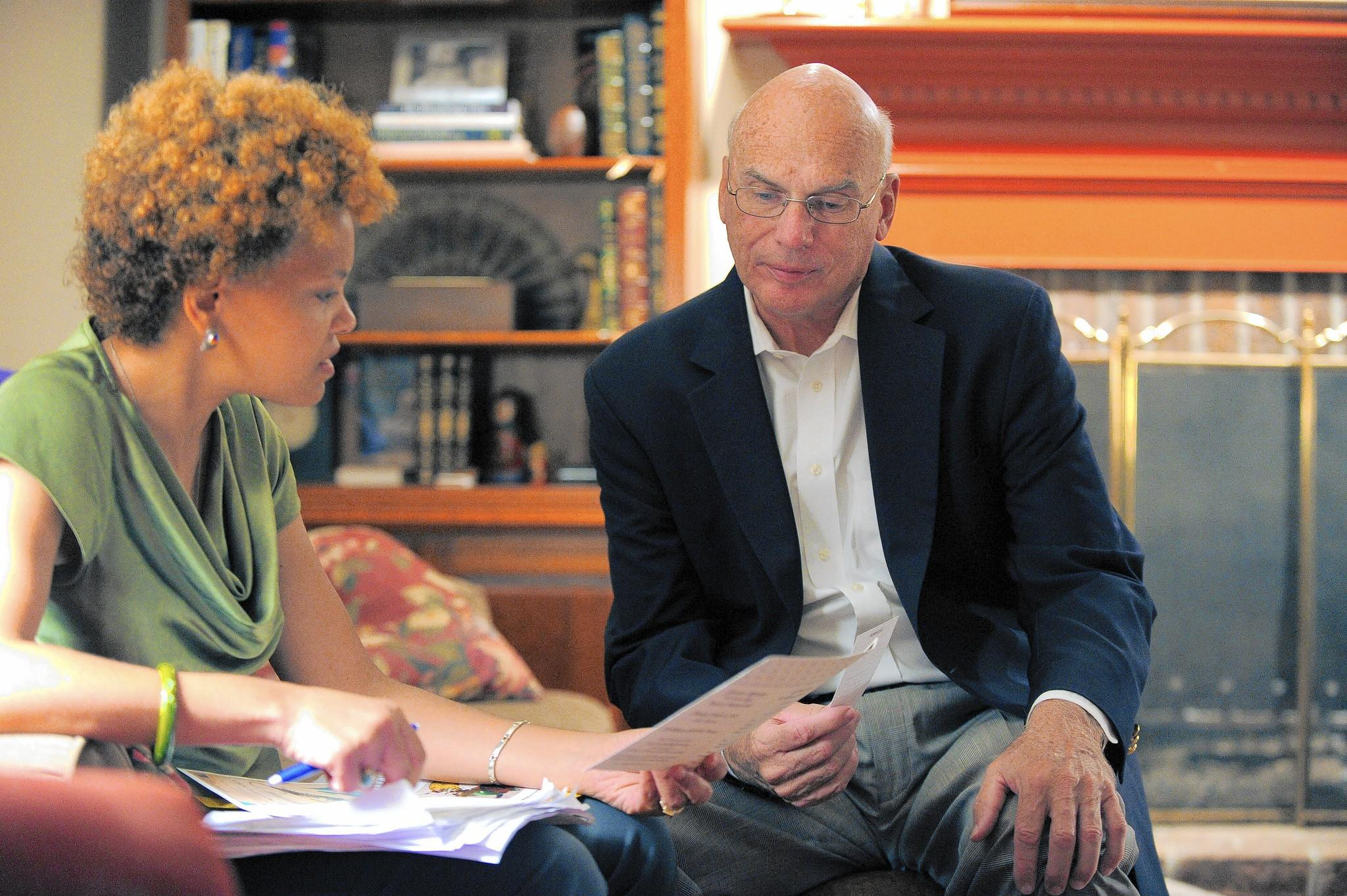 Terri Hill, a democratic candidate for District 12 delegate, reviews upcoming engagements with incumbent Sen. Edward J. Kasemeyer (D-12), who participates in a strategy session at his home Thursday, Sep 18, 2014.(