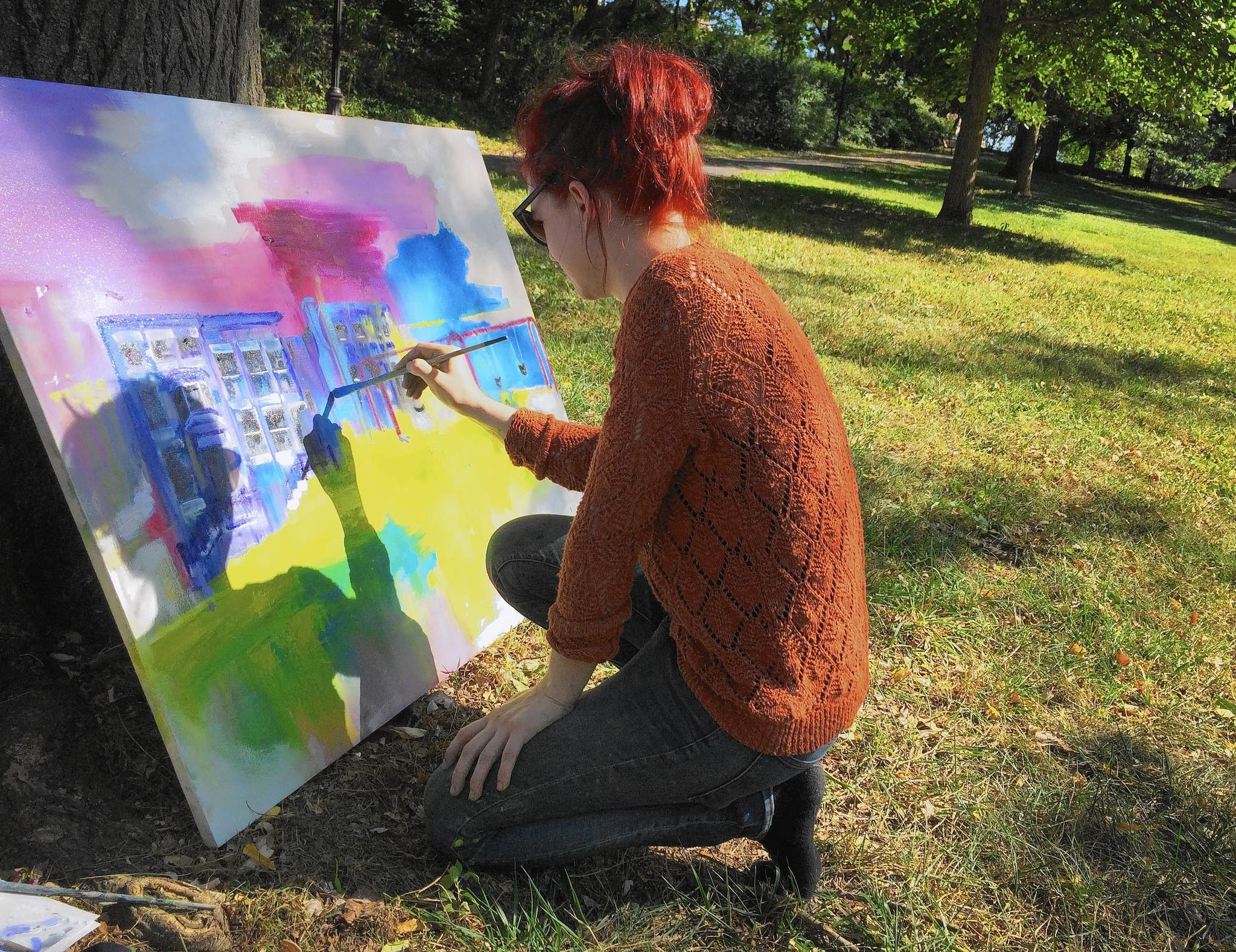"""Baltimore artist Chrissy Howland paints an abstract landscape of sights around Wyman Park Dell on Saturday. She was one of more than 40 artists participating in a """"paint out"""" at Johns Hopkins University."""