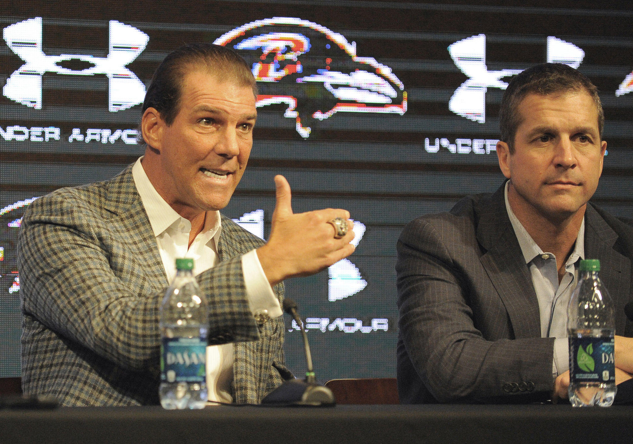 Ravens head coach John Harbaugh listens as team owner Steve Bisciotti answers a question at the team's season-in-review news conference in January.